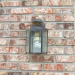 Old, builder installed coach light for house