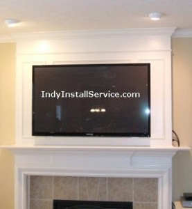 Flat screen TV mounting installation above fireplace
